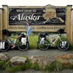 Our Santos Travelmaster Rohloff bikes at the Alaska - Canada border sign